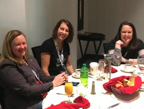 Women eating at table car wash conference
