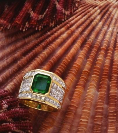 emerald and diamond ring on seashells