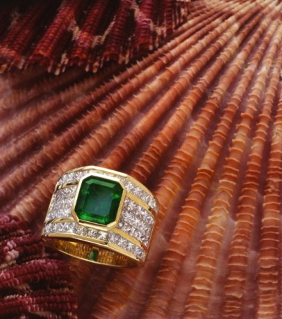 emerald and diamond ring on seashells