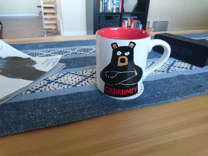 First cup of coffee on the coffee table. The mug does not at all describe my current mood!