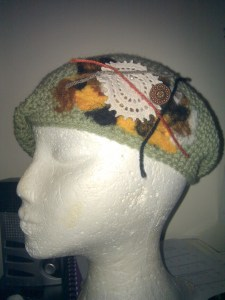 Crocheted hat with embellishment