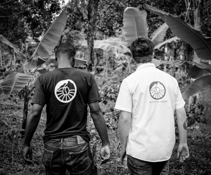 Haiti Coffee Academy manager Cantave and our single-origin roaster James Tooill look out at the Academy's young crop of coffee trees.