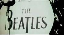 """Una enorme imagen de un sol se convierte en el bombo de la batería. Unos cables parecen cortar la """"b"""" de Beatles, de manera que parece un número 3. """"The 3 eatles""""."""