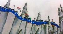 """Pero en contraste, desde las montañas grises, unos maléficos seres, los Blue Meanies, amenazan con romper esta armonía. Su jefe odia la música, odia el color, odia la palabra """"sí"""", odia todo lo que Pepperland simboliza. Quiere acabar con ella, controlarla y hacer que el mundo sea azul; es decir, triste. El color azul en esta película simboliza lo negativo. No puedo por menos que recordar el proyecto Bluebird, clave en la historia de la sustitución de Paul y otros acontecimientos de aquella época, algo que John es posible que supiera o intuyera ya por aquel entonces. De hecho, más adelante el propio jefe de los Meanies se dirigirá al guante como """"My Blue Bird"""". Y al final de la película admite ser """"el primo del Bluebird of Hapiness"""". Se trata de la maquinaria que quería controlarles, controlar la música y la juventud, la espontaneidad."""
