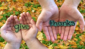 "hands holding ""give thanks"""
