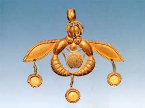 Famous Minoan jewel that depicts 2 bees holding a honey comb.