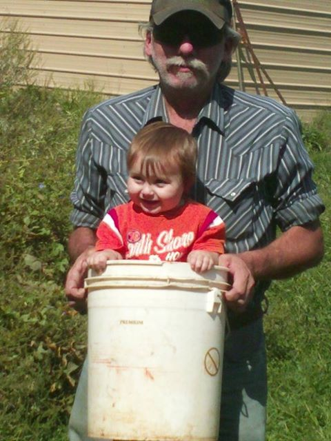 Grandson Camden goes everwhere with his grandfather on the Fitzringer farm.