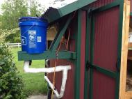 A rainwater cistern keeps the birds watered.