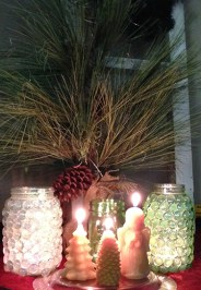 Grouped together, the Beeswax Christmas Candles and several jars make an impact.