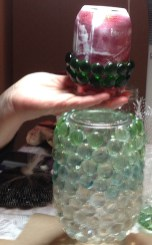 Karen's friend Norma shows that glitter-lined jars look odd at first, but in later shots, we see they dry clear.