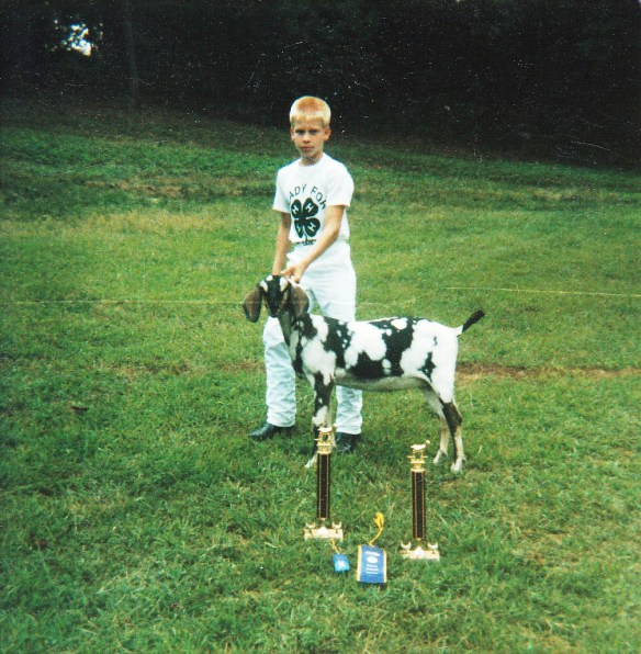The author's son, Michael with Dinah the goat and their trophies.