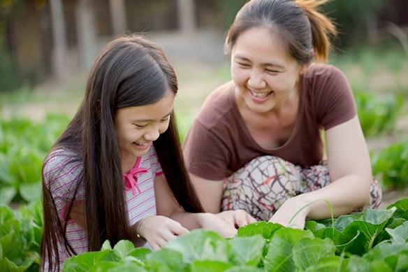 mom & daughter gardening