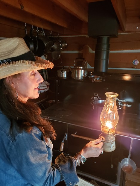 Stacy with oil lamp