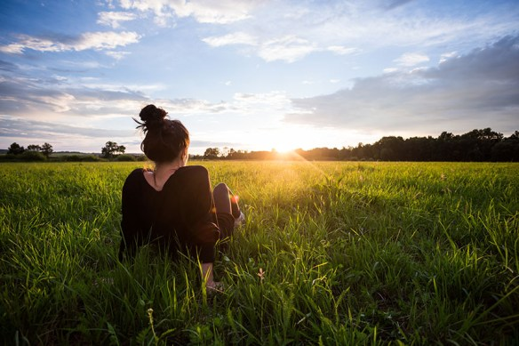 woman sitting in field