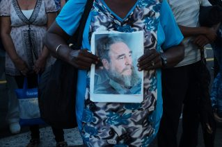 "A Cuban woman carries a portrait of Fidel Castro. She is in the long queue to pay homage to the ""Lider Maximo"", Fidel Castro, on the Plaza de la Revolucion in Havana, Cuba, on 28 November 2016. The former President of Cuba died of natural causes on 25 November 2016. He had held on to power for almost 50 years, until 2008 when he stepped down due to illness. Many Cubans feel a personal attachment with their leader, who is considered as a father of the nation by many."