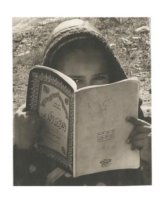 moroccan-girl-hiding-behind-her-book-morocco
