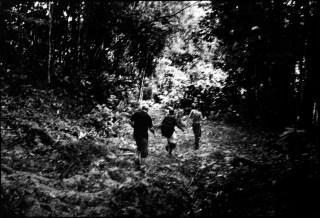 Colombian coyotes and a Cuban illegal migrant walk in the jungle during the trip from Colombia to Panama. The border area is called Darien and is the battle ground of the leftist guerrilla and right wing paramilitary. The trip takes 2-3 days to reach Panama.