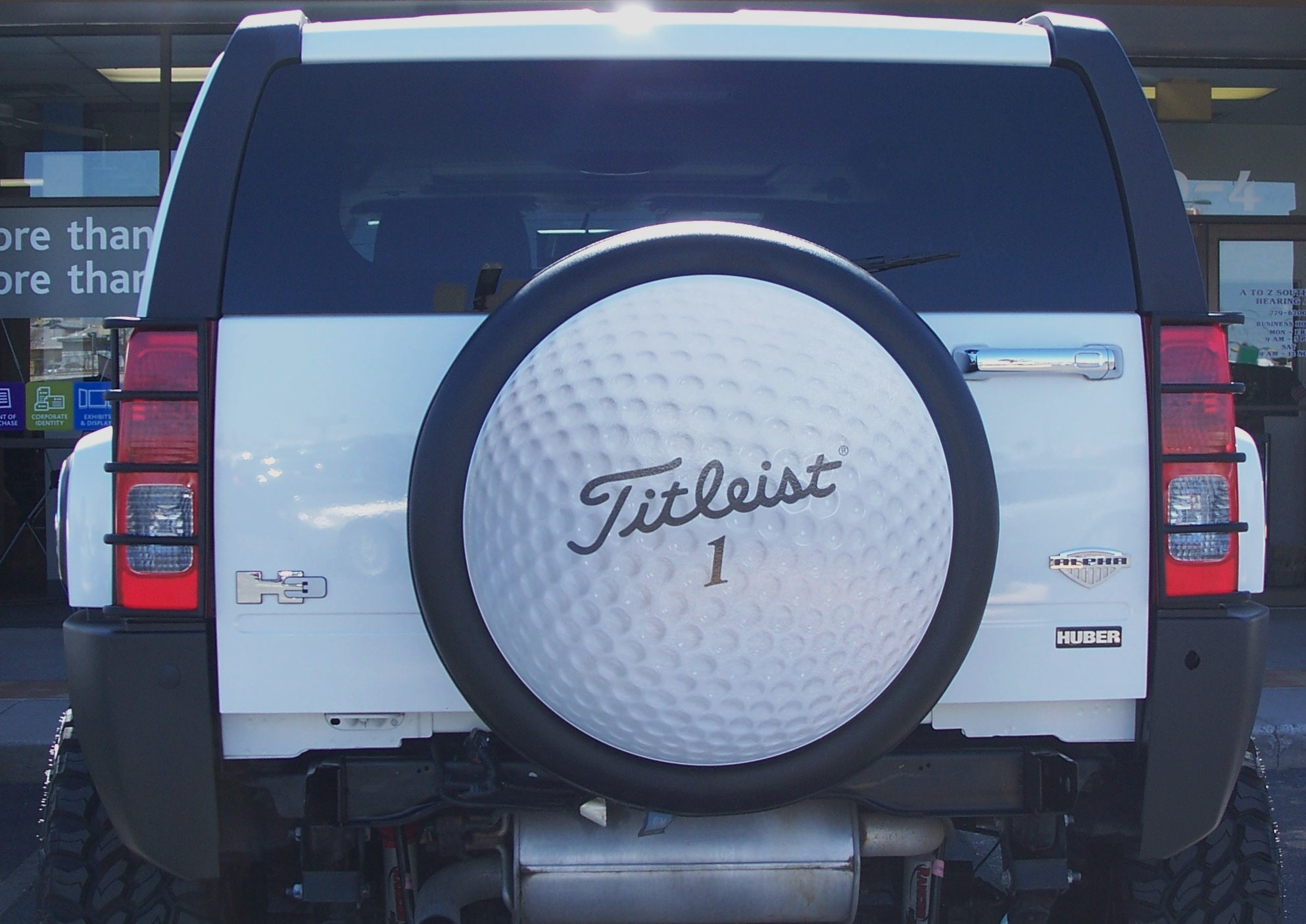 Hole in e with a Custom Golf Ball Print on a Tire Cover