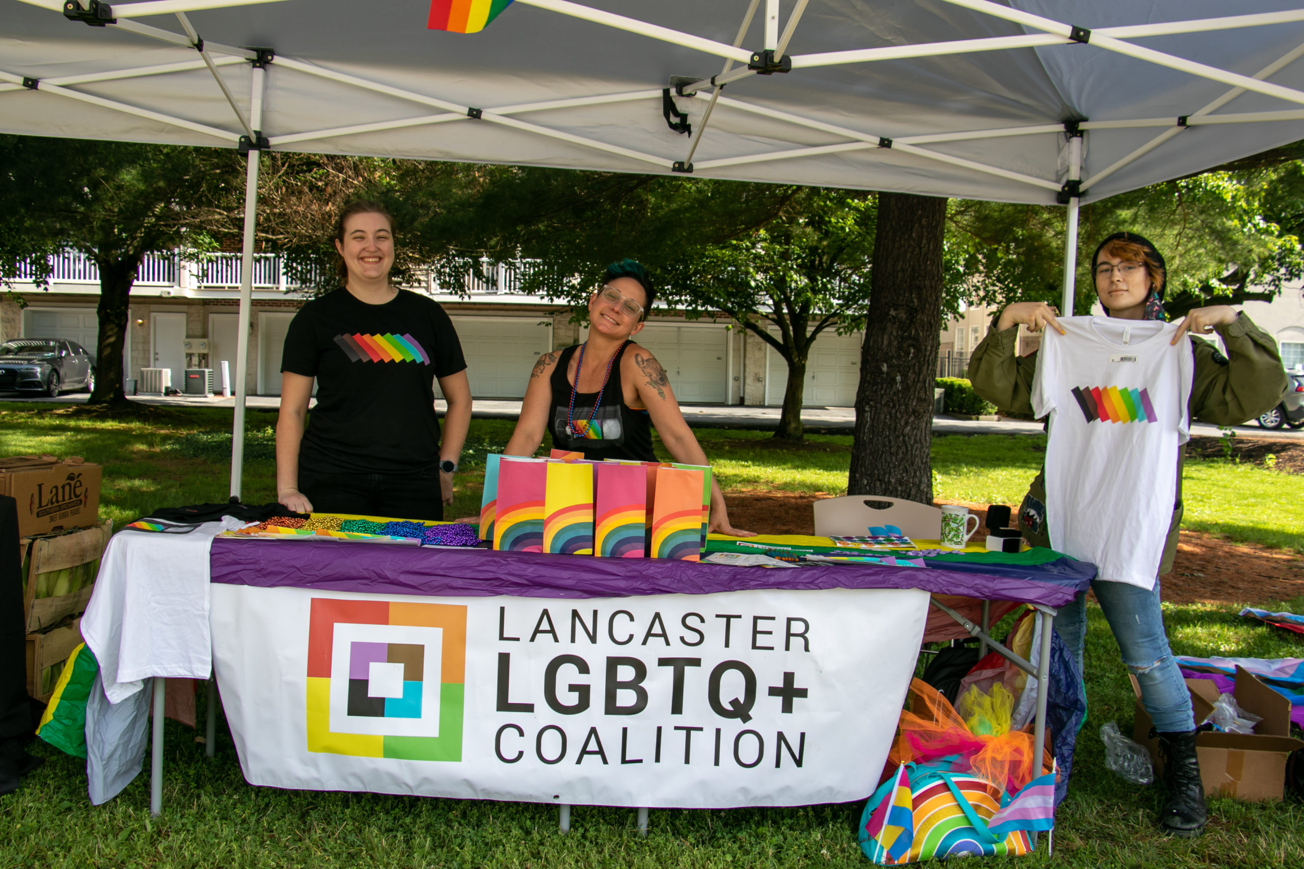 Coalition staff stand at a Coalition-branded table
