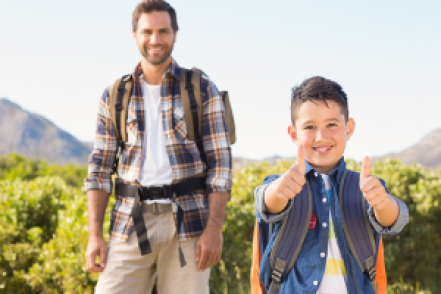 Father and son hiking outdoors.
