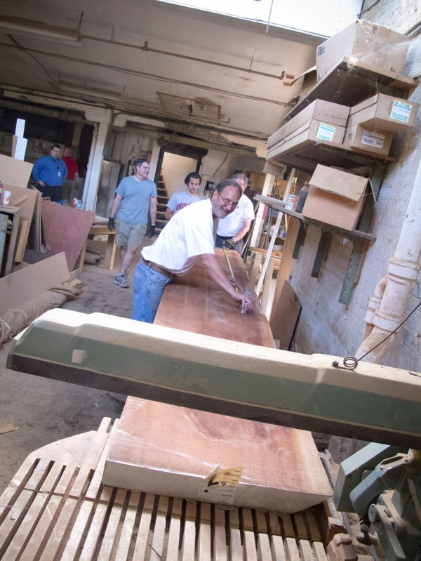 Daryl of Midwest attempts to cut a Sipo plank on a radial arm so. No dice.