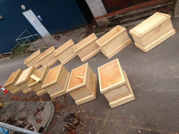 A dozen of the 19 chests we built in five days.