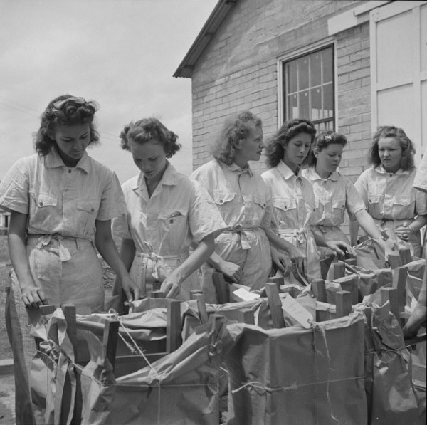 National Youth Administration girls with chairs they made ready for shipping, 1943.