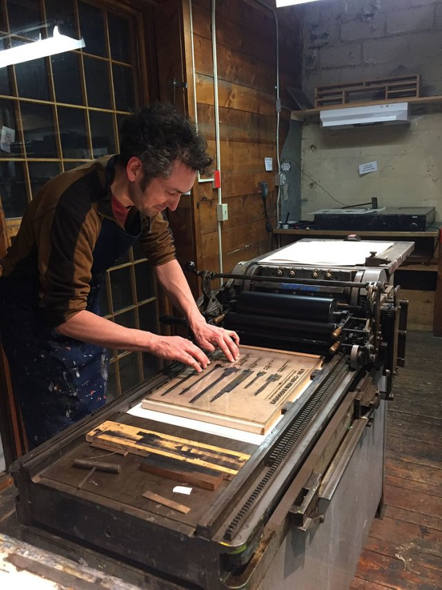 Abe getting ready to print using the Vandercook press at The Putney School.