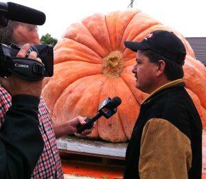 Leonardo Urena and his winning 1,704-pound pumpkin at Half Moon Bay's 2011 World Championship Pumpkin Weigh-Off