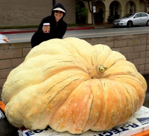 Alana with coffee standing behind the 1,794-lb disqualified pumpkin at Half Moon Bay's World Championship Pumpkin Weigh-Off 2011