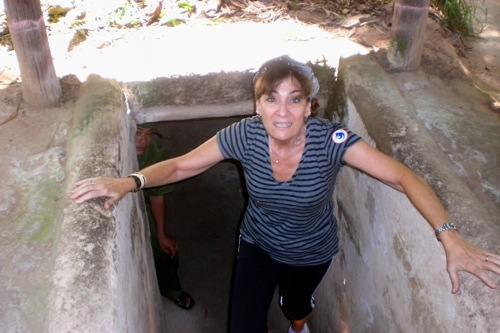 Bonnie climbing out of one of the tunnels at Cu Chi Tunnels, Vietnam © B. Miller