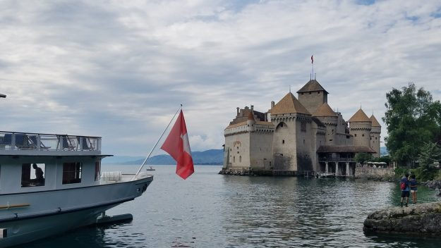 Montreux Chateau Chillon with boat and flag at left - Credit: Deborah Grossman