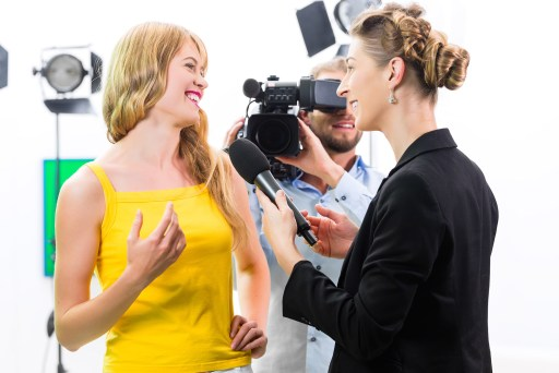 Reporter and cameraman film shoot actress interview on film set for TV or  Television