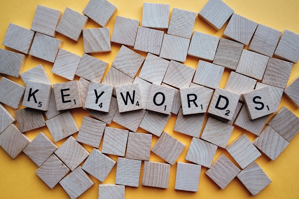 KEYWORD spelled out with Scrabble style tiles