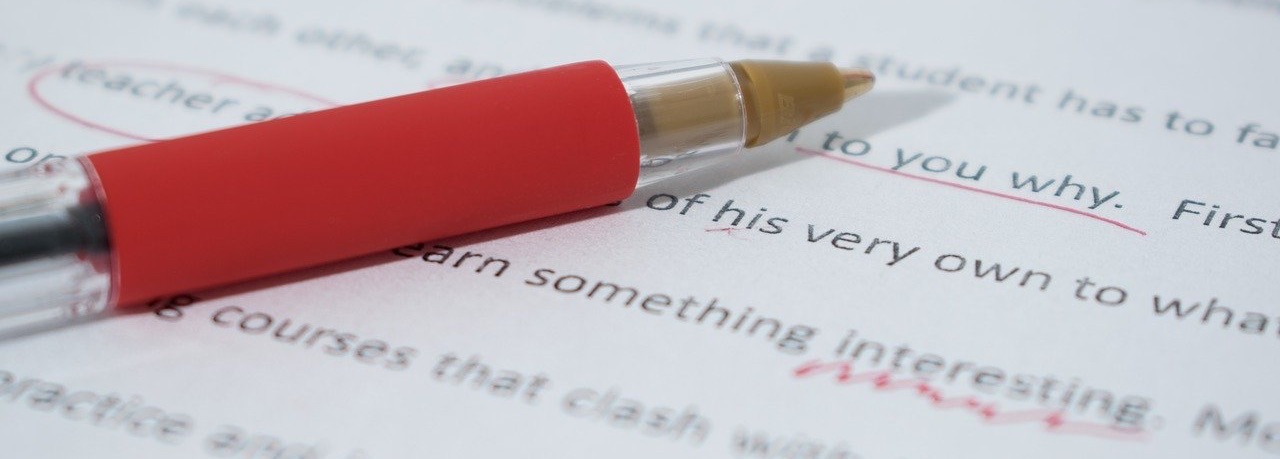Red pen underlining edits. Source: https://pixabay.com/photos/correcting-proof-paper-correction-1870721/