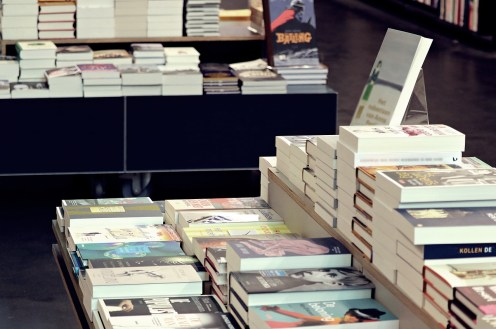 Stock image from Pixabay of a bookstore shelf and stack of books