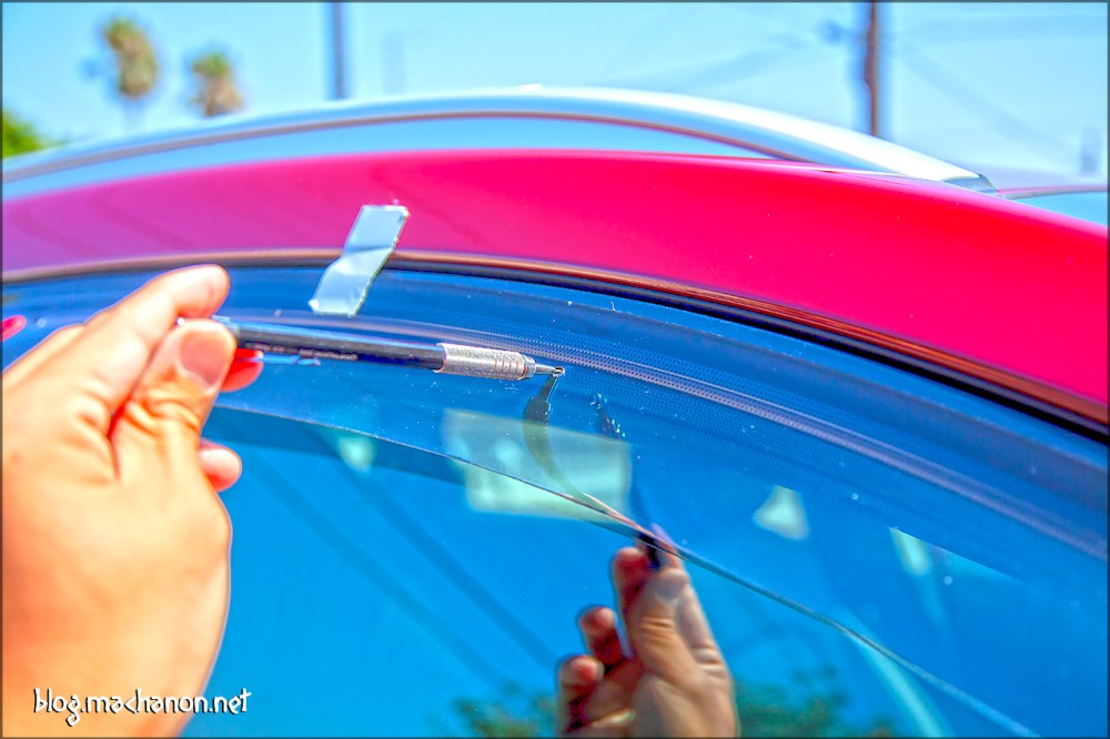 Mark the rubber door frame weather stripping by inserting a pencil through each of the three holes on the visor.