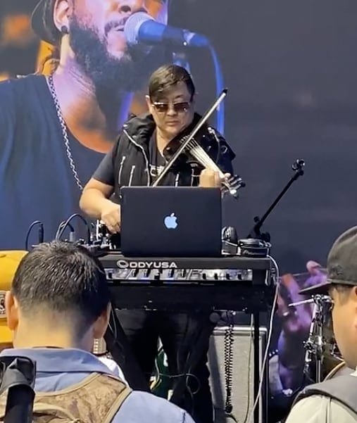 Dave Kim plays the OWC booth at NAMM 2020