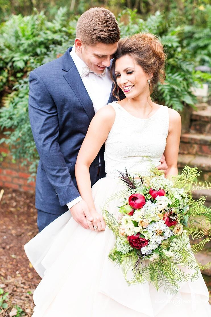 bride and groom models in garden setting