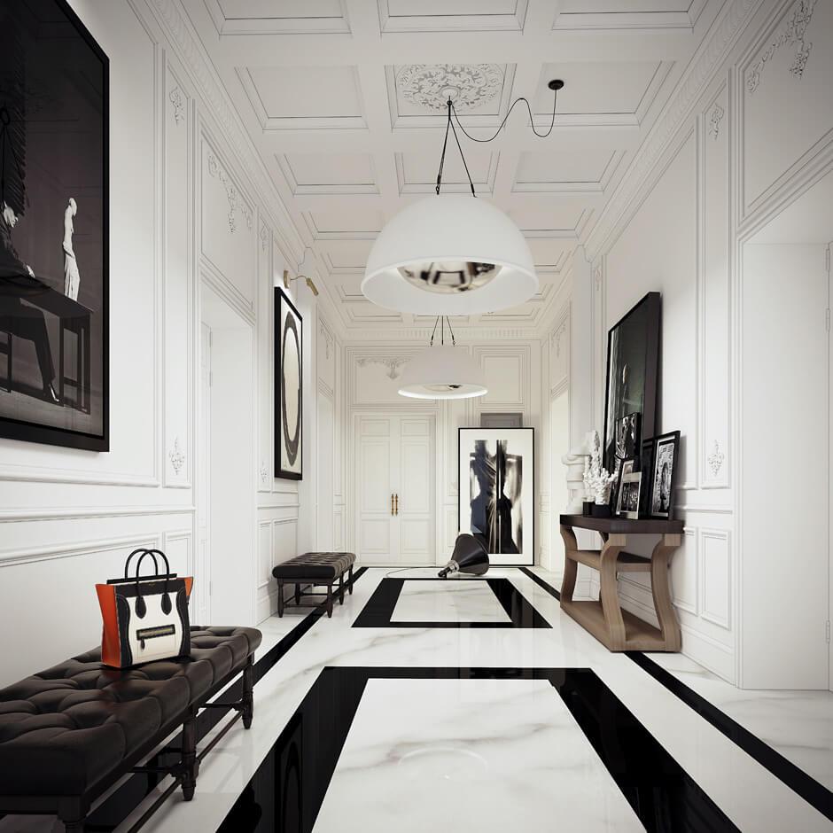Un hall d'entrée très chic avec son sol en marbre et ses grandes banquettes de cuir noir. Retrouvez toutes les images de cet intérieur luxueux dans l'article.