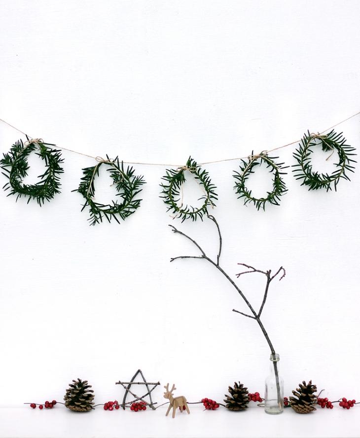 Découvrez comment fabriquer une guirlande de couronne de Noel en sapin pour décorer votre intérieur