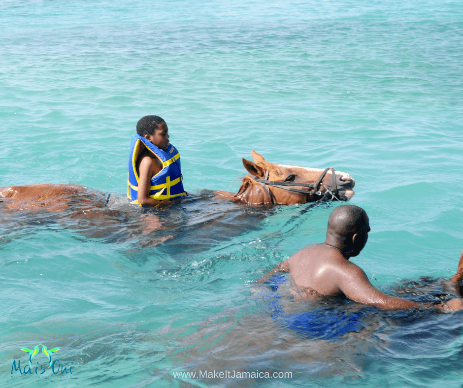 Swimming in the sea on horseback with Braco Stables Jamaica