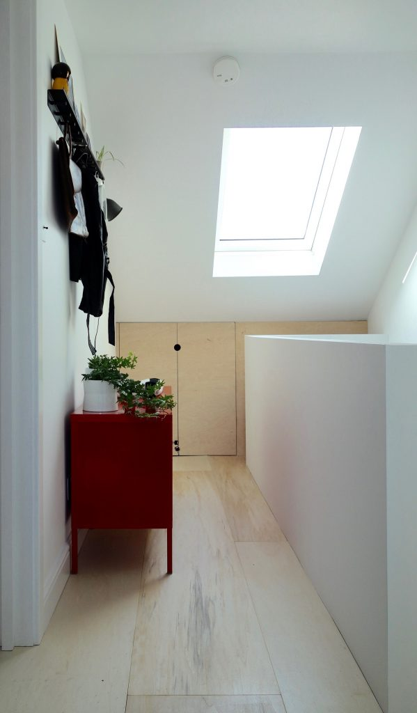 Loft landing with plywood floor and hanging rail
