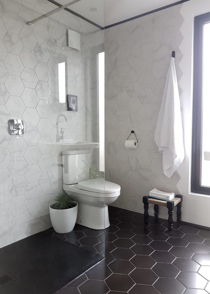 Walk in shower room with marble hex tiles