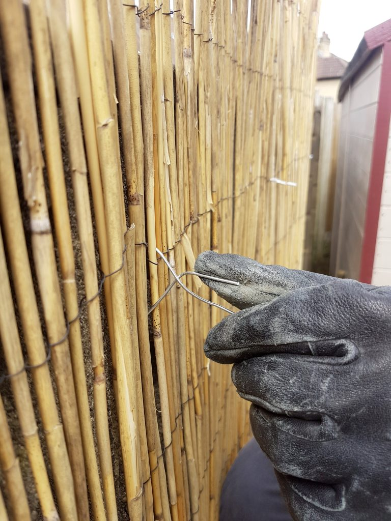Fixing the bamboo screening with wire