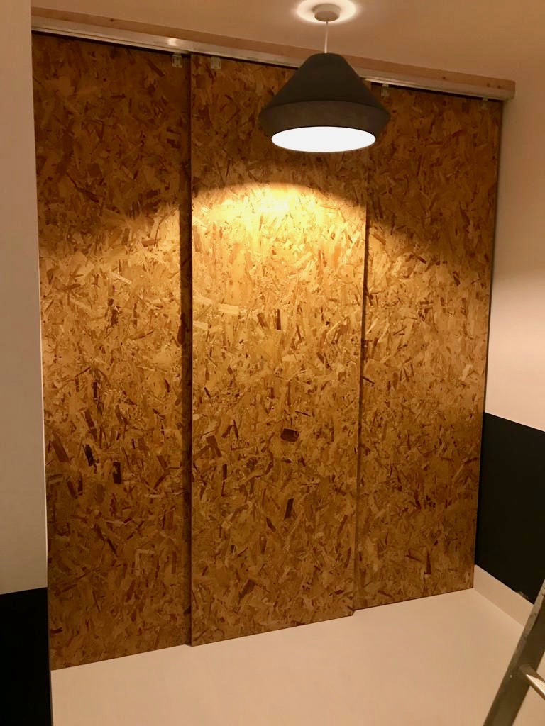 Integral Garage Conversion - OSB Sliding Wall