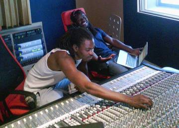 C.O and Marko Sadik working in a recording studio in The Netherlands