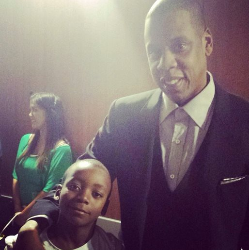 Picture of Madonna's son, David Banda, with Jay Z at the 2014 Grammy Awards