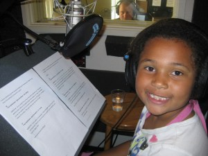 "Ayiana is hard at work recording the ""A is for Art"" tour. Photo by Sandy Goldberg."