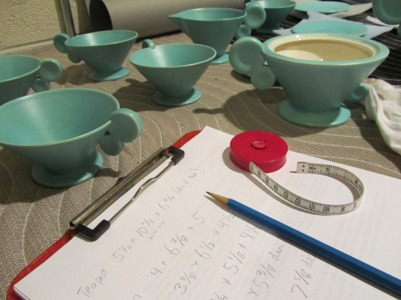 Examining and recording details on the Grete Marks tea service after it arrived at the Museum. Photo by the author.